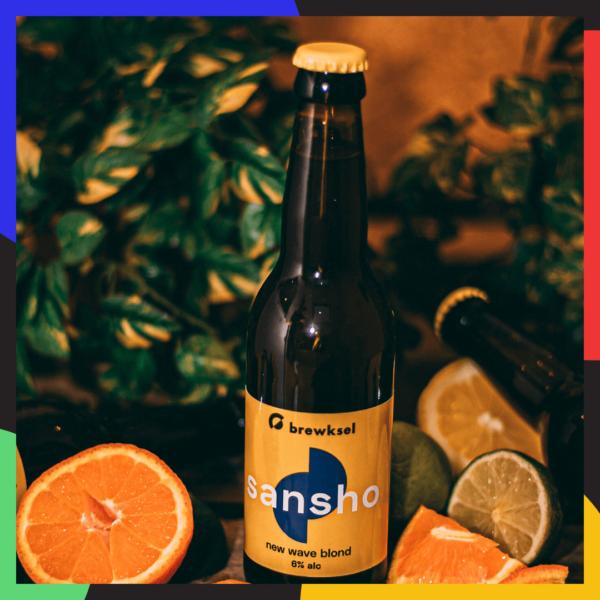 sansho beer bottle and citrus fruit